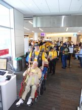 2013 04 19c-Honor Flight getting on plane with George Peabody