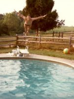 1983-08-Michael diving in the pool at Uncle John's house, Aspen Hill, Maryland