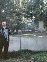 2004-12b-Michael at the Forrest Gump movie bench site which is at the north side of Chippewa Square in Savannah, GA