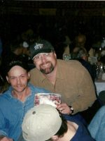 2005-03b-Michael & 2004 Iditarod winner Mitch Seavy at the pre-race dinner in Anchorage, Alaska