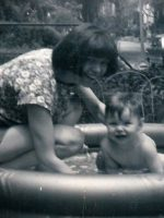 1963-07-Mom and baby Michael playing in the baby pool