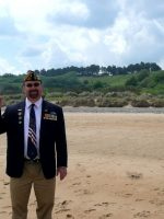 2010-06b-Michael on D-Day Omaha Beach with Sand in Normandy, France