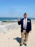 2010-06d- Michael on D-Day Sword Beach with Sand in Normandy, France