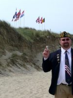 2010-06j-Michael on D-Day Utah Beach with Sand in Normandy, France
