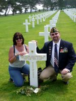 2010-06k-Mary & Michael at D-Day Omaha Beach Cemetery at MOH Roosevelt grave in Normandy, France