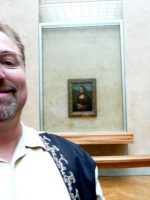 2010-06zc-Michael with the Mona Lisa painting in the Louvre Museum in Paris, France