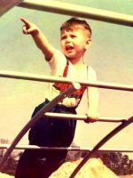 1965a-Michael playing on the jungle gym