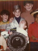 1971-10-Christian with crown & Michael tallest in brown shirt with their friends