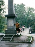 2002-09p-Michael at North Bridge Monument (Shot hear around the World) in Concord, MA